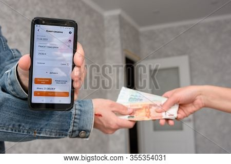 Anapa, Russia - March 11, 2020: Self-employed Person Receives Money For The Repair Of The Premises A