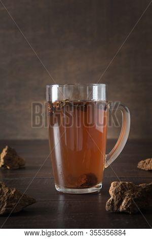 Organic Chaga Mushrooms Hot Coffee In Glass Cup. Trendy Healthy Clean Eating Beverage On Dark.