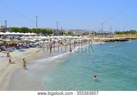 Kato Gouves, Crete, Greece - June 8, 2019 : Tourists On Kato Gouves Beach In Crete The Largest And M