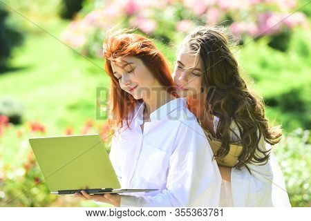 Female College Students On Campus Outdoors. Education, Campus, Friendship And People Concept - Group