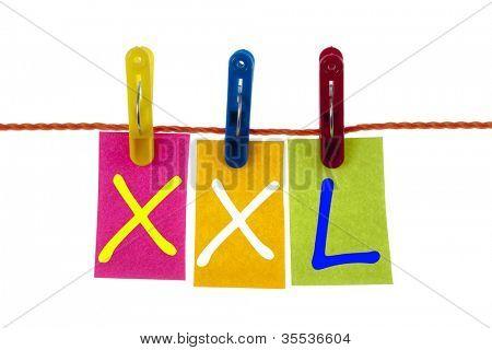 XXL word on laundry hook on white