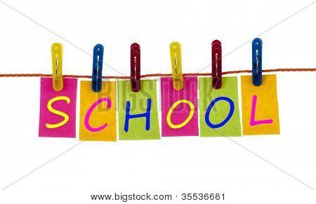 School word on laundry hook on white