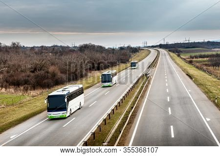 Three Local Line Buses In Line Traveling On A Highway Country Highway