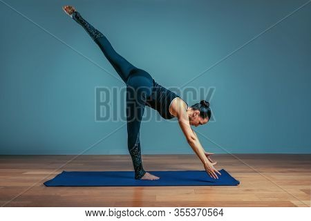 Young Asian Woman In The Bakasana Crane Yoga Pose. Attractive Female Practicing Handstand Asana For