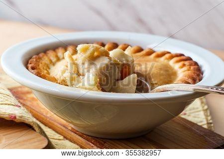 Crispy Flaky Baked Chicken Pot Pie In White Bowl
