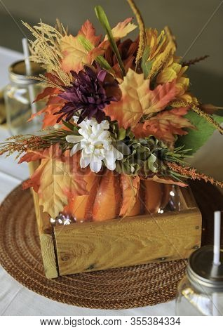 Table Centerpiece In Fall Colors Suitable For A Wedding, Anniversary Or Seasonal Party.