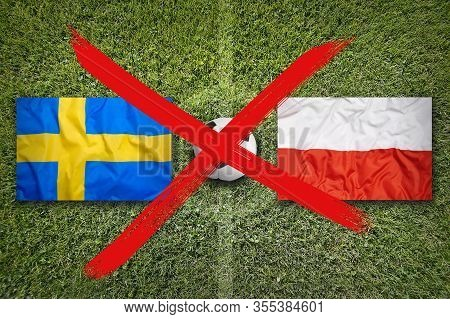 Canceled Soccer Game, Sweden Vs. Poland Flags On Soccer Field