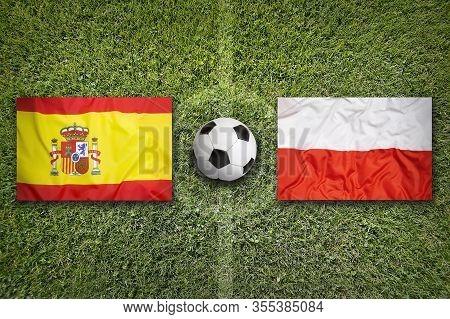 Russia Vs. Denmark Flags On Green Soccer Field