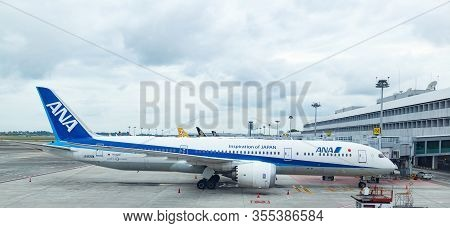 Changi Airport, Singapore - June 12, 2019: Air Nippon Airways And Singapore Airlines Planes Are Park