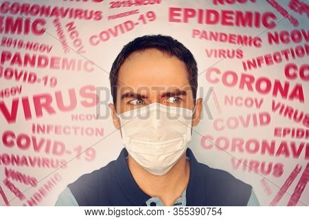 A Man With A Mask On His Face, Scared By The News Of The Coronavirus Covid-2019. Panic Situation. Fe