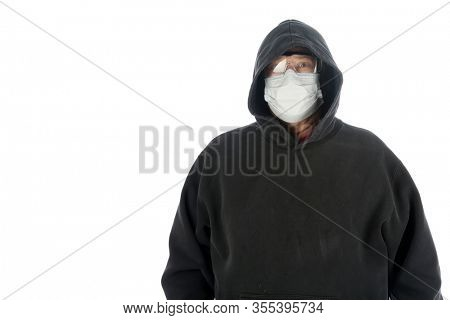 2019 Novel Coronavirus. 2019-nCoV. Wuhan, China 2019 Novel Coronavirus. a Man wears a sweat shirt, paper mask and glasses to avoid COVID19.  World Wide Pandemic. World Wide Coronavirus Pandemic.