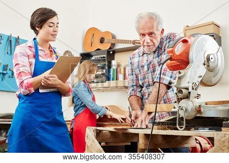 Woman is doing apprenticeship in guitar maker and making notes on a clipboard