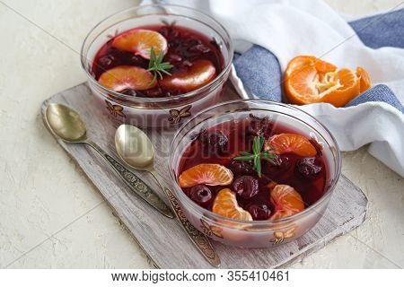 Dessert, Sweet Fruit Jelly With Cherries And Tangerines In Portioned Bowls On A Gray Concrete Backgr