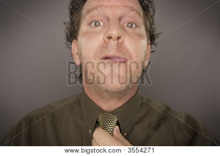 Man Concentrating Fixing Tie