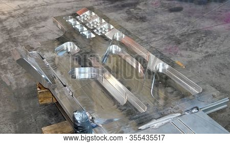 Silver Bent Aluminium Profile. Fragment Of Alu Products. Detail Of Stainless Steel Background, Textu