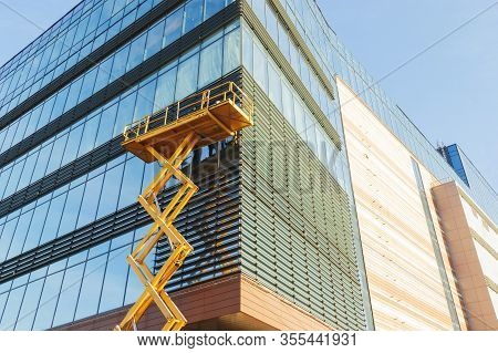 Russia, Nizhny Novgorod, November 2019: Builders On The Air Platform During Installation Of Facade G