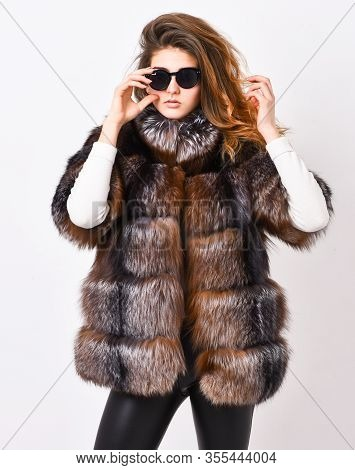 Fur Fashion Concept. Winter Elite Luxury Clothes. Female Brown Fur Coat. Fur Store Model Enjoy Warm
