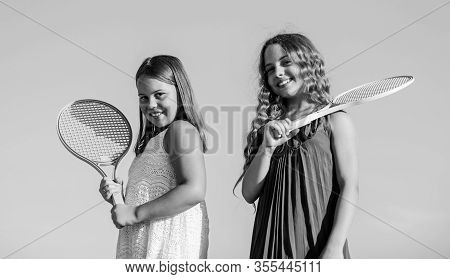 Sport Is Our Life. Small Girls With Tennis Racquet. Summer Sport Activity. Energetic Children. Happy