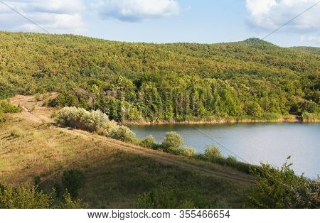 Rural Summer Landscape. Small Lake In Crimean Mountains At Sunny Summer Day Under Cloudy Sky