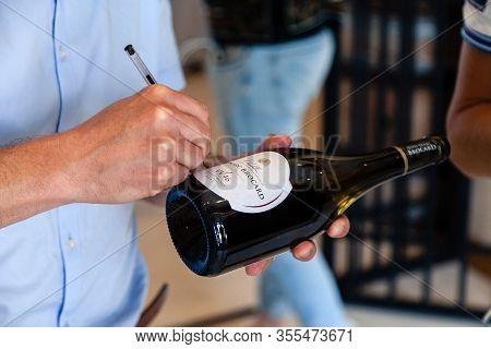 France Chablis 2019-06-21 Winemaker Leave Sign On Wine Bottle