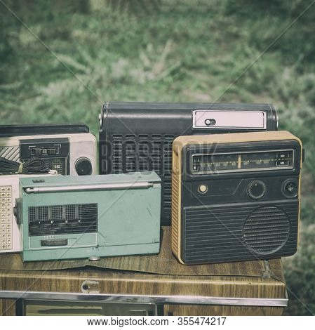 Old Transistor Radios On The Table. Old Compact Transistor Receiver