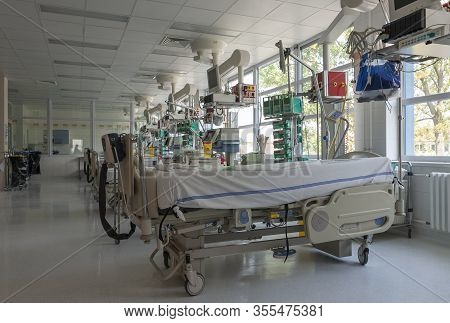 Intensive Care Unit In Hospital, Beds With Monitors An Ventilators, A Place Where They Are Treated P