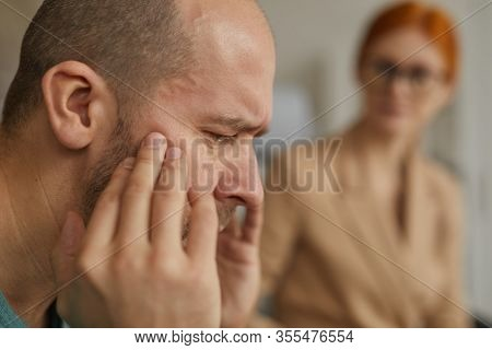 Close-up Of Depressed Mature Man Worring About His Problems And He Visiting Psychologist