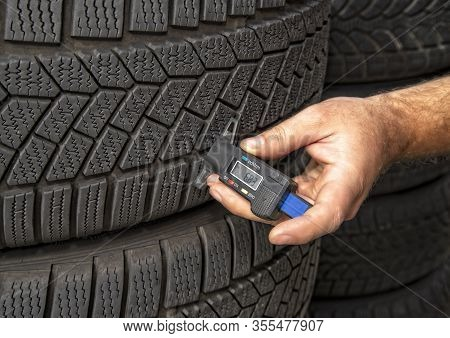 Measuring The Tread Depth Of A Tire With A Digital Measuring Device