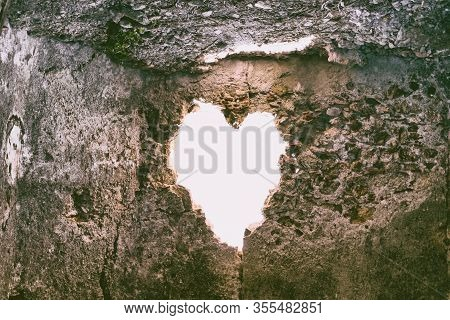 Heart-shaped Hole In The Wall Of An Old Ruined House