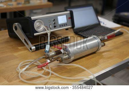 Radon Gas Radiation Detectors Testing. Dosimetrist Holding A Portable Gamma Radiation Dosimeter Set