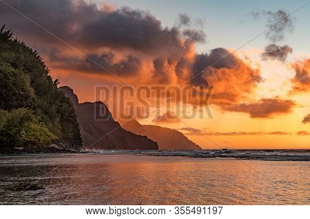 Sunset Lights The Receding Cliffs Of The Napali Coastline On North Coast Of Kauai In Hawaii