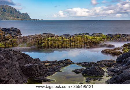Long Exposure Of The Calm Waters Of Queens Bath, A Rock Pool Off Princeville On North Shore Of Kauai