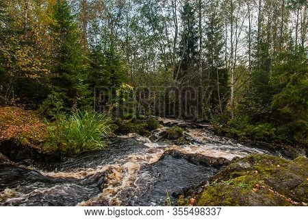 A Small River In The Karelian Forest. Ruskeala Waterfalls.