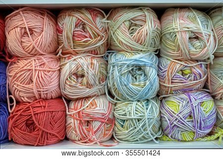 Background With Colorful Balls Of Yarn For Sale In Shop.