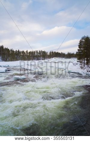 Storforsen, A Rapid In The Pite River In Swedish Norrbottens Län. With An Average Flow Of 250 M3/s,