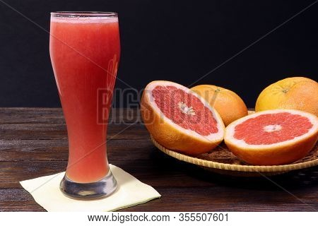 A Glass Of Fresh Grapefruit Juice And Grapefruit Fruits On A Wooden Table. Healthy Food.