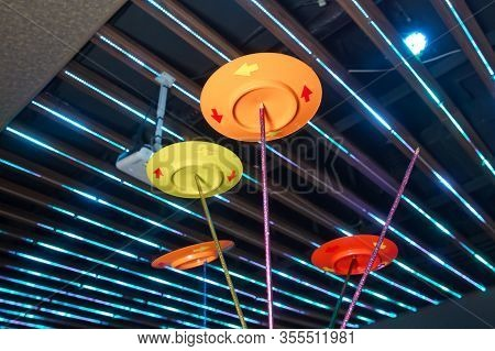 Fun With Spinning Plates .balancing A Spinning Plate. A Collection Of Spinning Yellow, Blue, Red Pin