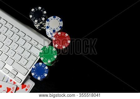 Computer Keyboard Located At The Top Left, Surrounded By Cards And Poker Chips Of Different Colors A