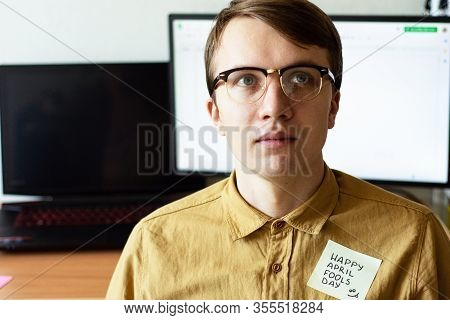 April 1St Fools' Day.man In Glasses With Sticker On Shirt.displeased Face Of Man On White Background