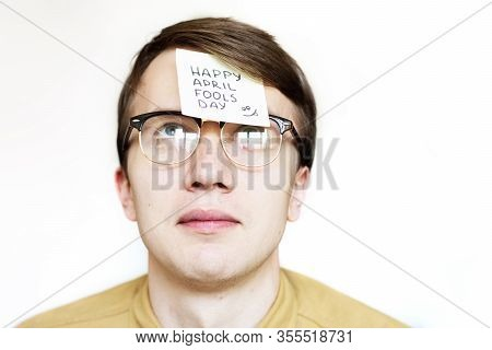 April 1St Fools' Day.man In Glasses With A Sticker On His Face.sticker On Forehead.office Jokes.disp