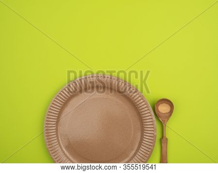 Eco-ware On A Bright Green Background. The View From The Top.