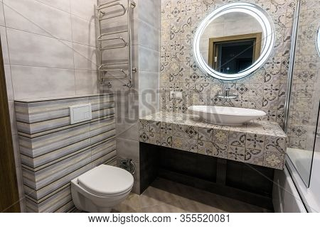 The Interior Of A Modern Bathroom Combined With A Toilet