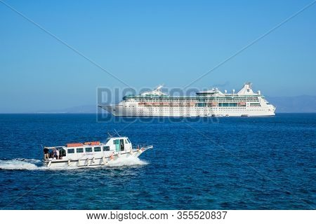 MYKONOS, GREECE - MAY 29, 2019: Cruise liner ship Costa Luminosa in Mediterranea sea near Mykonos island. Aegean sea, Greece