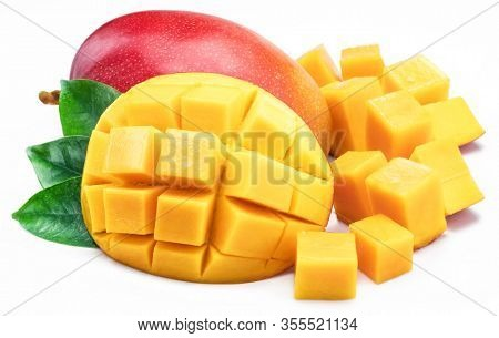 Mango fruit with mango cubes. Isolated on a white background.