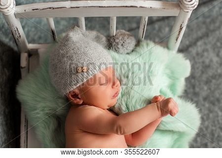 Newborn Child. Newborn Photo Shoot. A Baby Boy Is Peacefully Sleeping During His First Professional