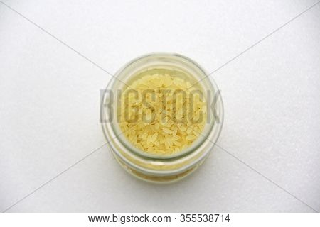 Glass Jar With Rice On A White Background, Top View. The Concept Of Healthy Nutrition, Diets, Vegeta