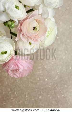 Elegance Ranunculus Bouquet On The Sparkling Background. Beautiful And Tender Flowers Composition In