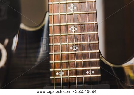 Close-up View Of Guitar Frets On An Electric 7-string (seven String) Guitar.