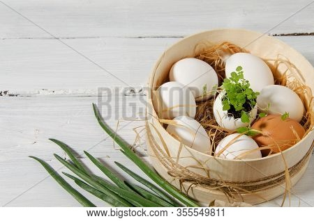 Easter Background. In A Sieve In The Hay There Are White Chicken Eggs, One Egg In The Center With Sp