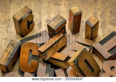 closeup of vintage letterpress wood type printing blocks - craftsmanship concept